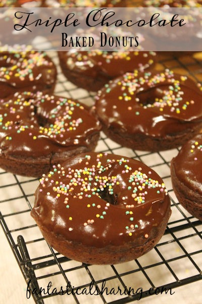 Triple Chocolate Baked Donuts // Breakfast just got a little sweeter with these chocolatey homemade donuts #recipe #chocolate #donuts #breakfast #Choctoberfest