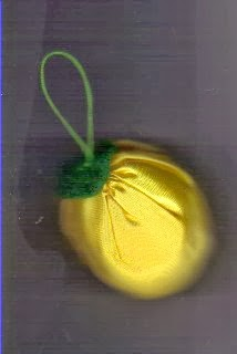 Yellow fabric Christmas ornament shaped like lemon
