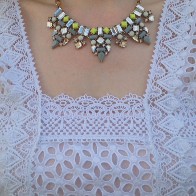 What Lizzy Loves Broderie anglaise tunic and pale cropped jeans and statement necklace from Happiness Boutique