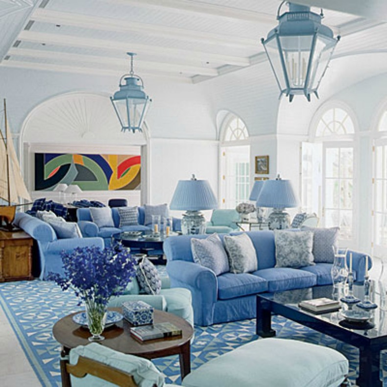 Blue coastal living room with blue slipcover sofas
