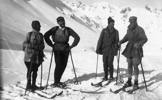 group of four skiers in the 1920s