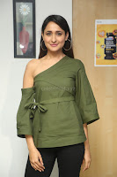 Pragya Jaiswal in a single Sleeves Off Shoulder Green Top Black Leggings promoting JJN Movie at Radio City 10.08.2017 075.JPG