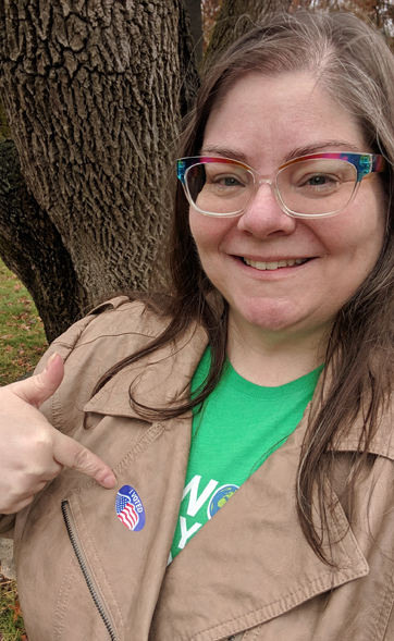 image of me standing outside proudly sporting an 'I Voted' sticker