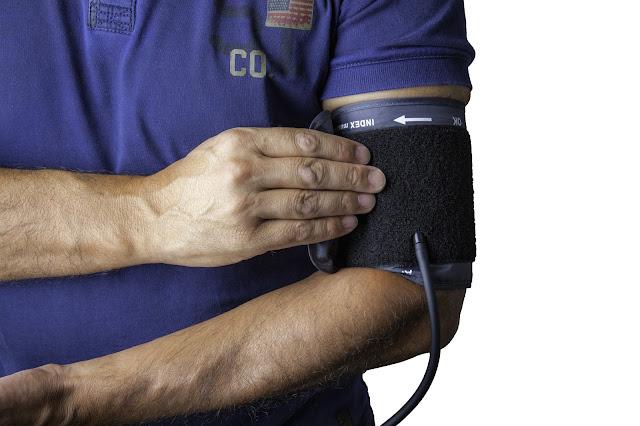 Image of man testing blood pressure