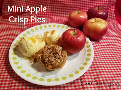 Blog With Friends, multi-blogger posts. This month's theme: Apples | Mini Apple Crisp Pies by Eileen of Eileen's Perpetually Busy | Shared on www.BakingInATornado.com