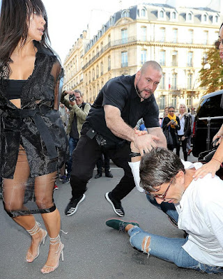 Kim Kardashian has butt kissed by journalist in Paris