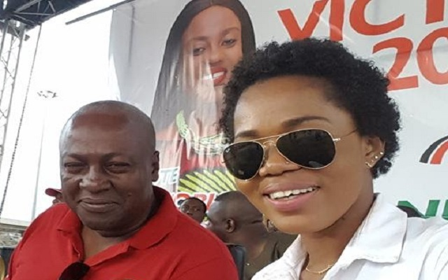 Former President John Dramani Mahama and Nana Akua aka Mzbel (Right)
