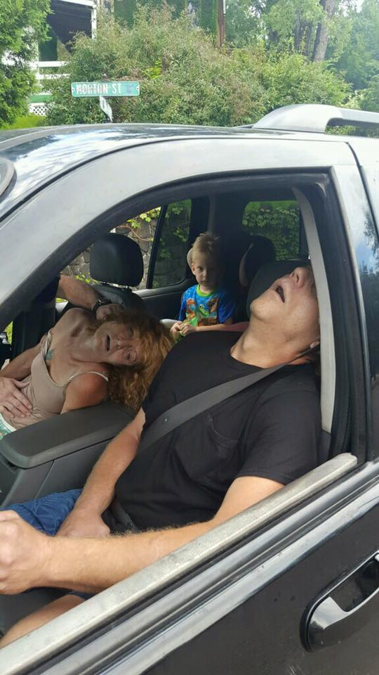 The photos show James Acord, 50, and Rhonda Pasek, 47, passed out in the front seat of their Ford Explorer, their mouths agape (wide open in surprise or wonder), as the 4 years old child stares silently into the camera from the back.