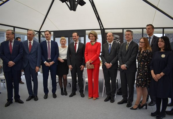 Belvas company is organic chocolate factory in Europe. Queen Mathilde wore Natan red pantsuit and Natan shoes