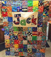 http://hangryfork.com/sewing-projects/jacks-i-spy-baby-quilt-with-applique/