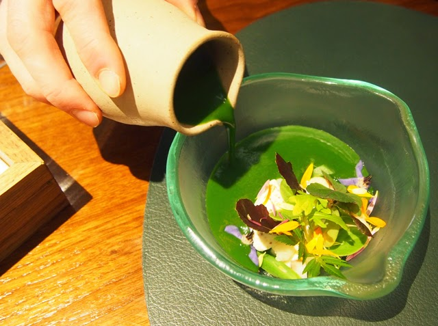Aynsome soup of mixed leaves, mustard, eel, soft herbs and flowers