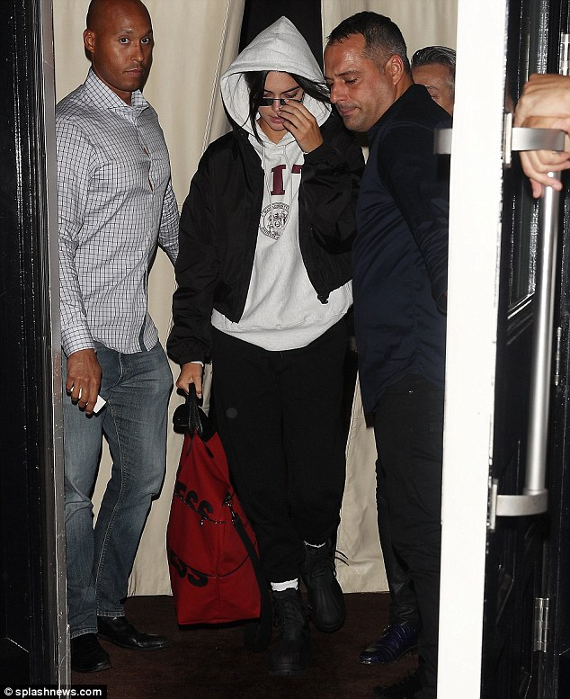 Kendall Jenner keeps a low-profile as she touches down Paris after not being booked to walk in any shows during NYFW