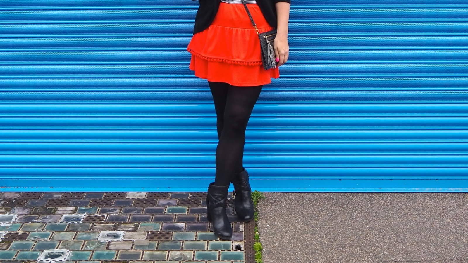black tights with orange skirt