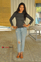 Actress Bhanu Tripathri Pos in Ripped Jeans at Iddari Madhya 18 Movie Pressmeet  0054.JPG