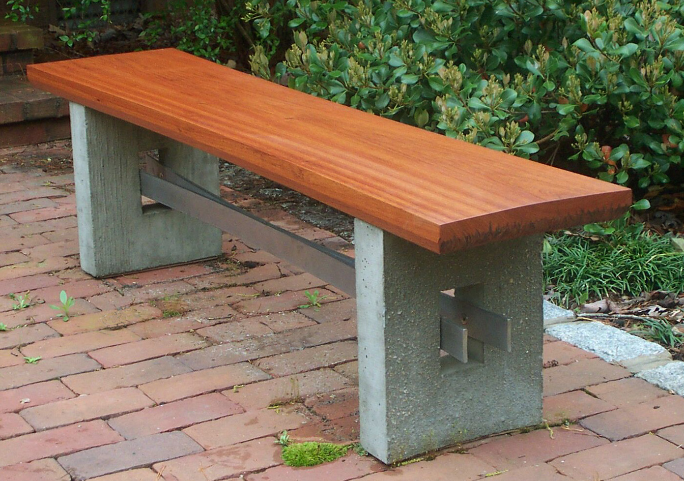 Beautiful outdoor benches complete a garden Stone garden bench