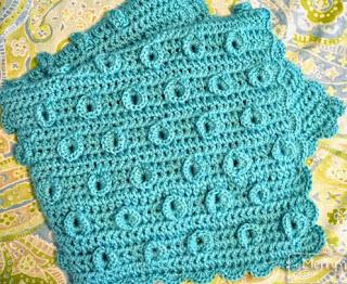 http://translate.google.es/translate?hl=es&sl=en&tl=es&u=http%3A%2F%2Fmymerrymessylife.com%2F2014%2F04%2Fcrochet-lily-pad-baby-blanket-free-crochet-pattern.html