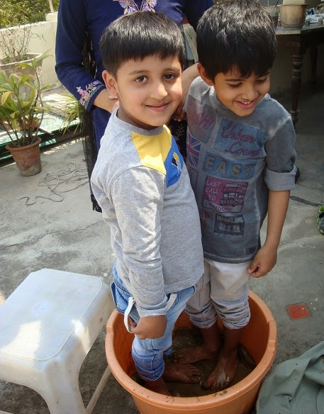 Kids having fun with mud