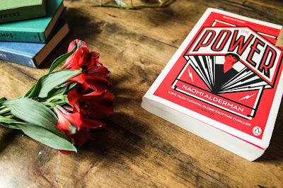 The Power by Naomi Alderman, Book Review on Typewriter Teeth with flowers and a stack of books