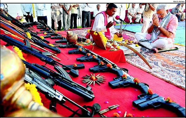 TERRORISM IN INDIA: Narendra Modi worshipping Weapons