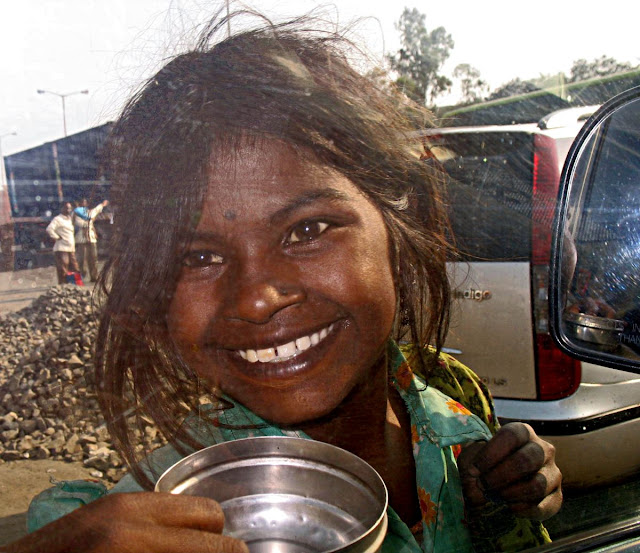 beggar girl with a brilliant smile