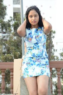 Actress Priyankha Stills in Floral Short Dress at Golmal Gullu Movie Pressmeet 0246.JPG