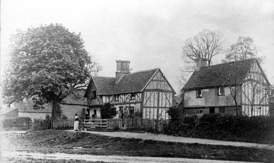 Timber-framed cottages on the green at Water End c 1900  Image from P. Grant / G. Knott, part of the Images of North Mymms collection