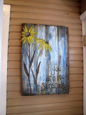 letrero de madera reciclado y pintado