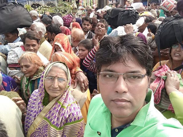 IN the long queue for offering PUJA to Kapil Muni