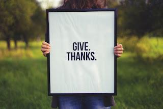 Sign saying Give Thanks