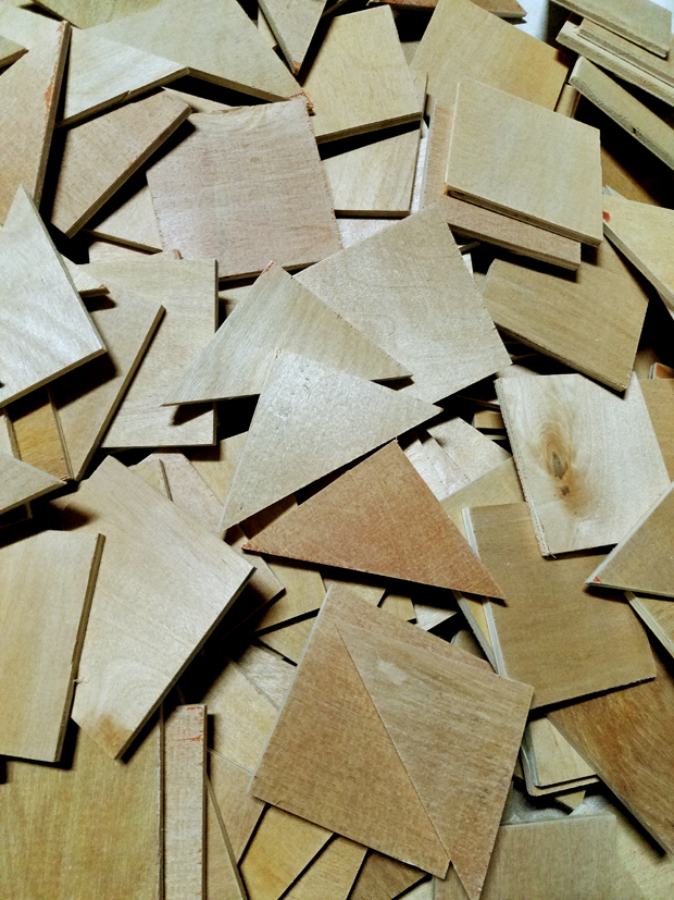 quarter inch plywood cut into three inch squares and triangles