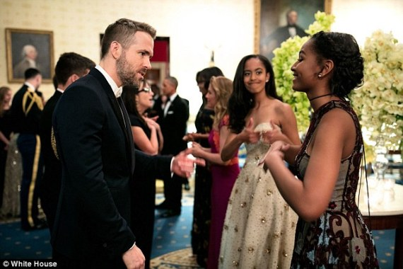 Malia Obama gives sister Sasha thumbs up for getting the attention of handsome actor, Ryan Reynolds