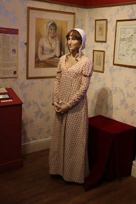 Portrait and waxwork of Jane Austen  on display at the Jane Austen Centre in Bath