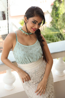 Janani Iyer looks fabulous super cute in a lovely Tank Top and White Skirt