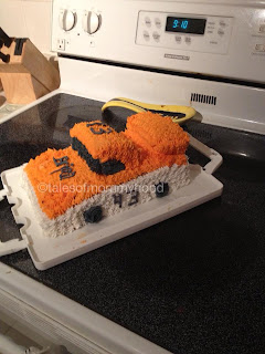 white and orange Nascar birthday cake