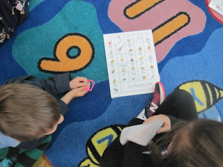 Kids working on the alphabet