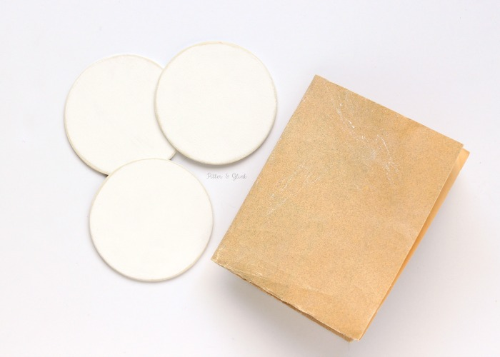 Sand wooden disks for a smooth surface to apply vinyl