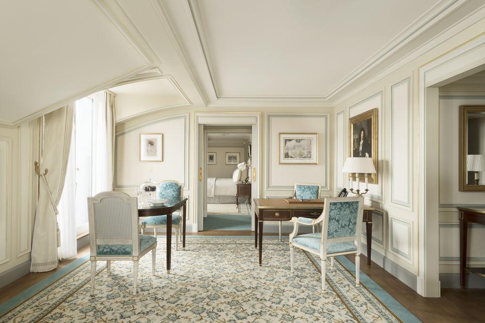 Beautiful blue and cream guest suite at Ritz Paris Hotel