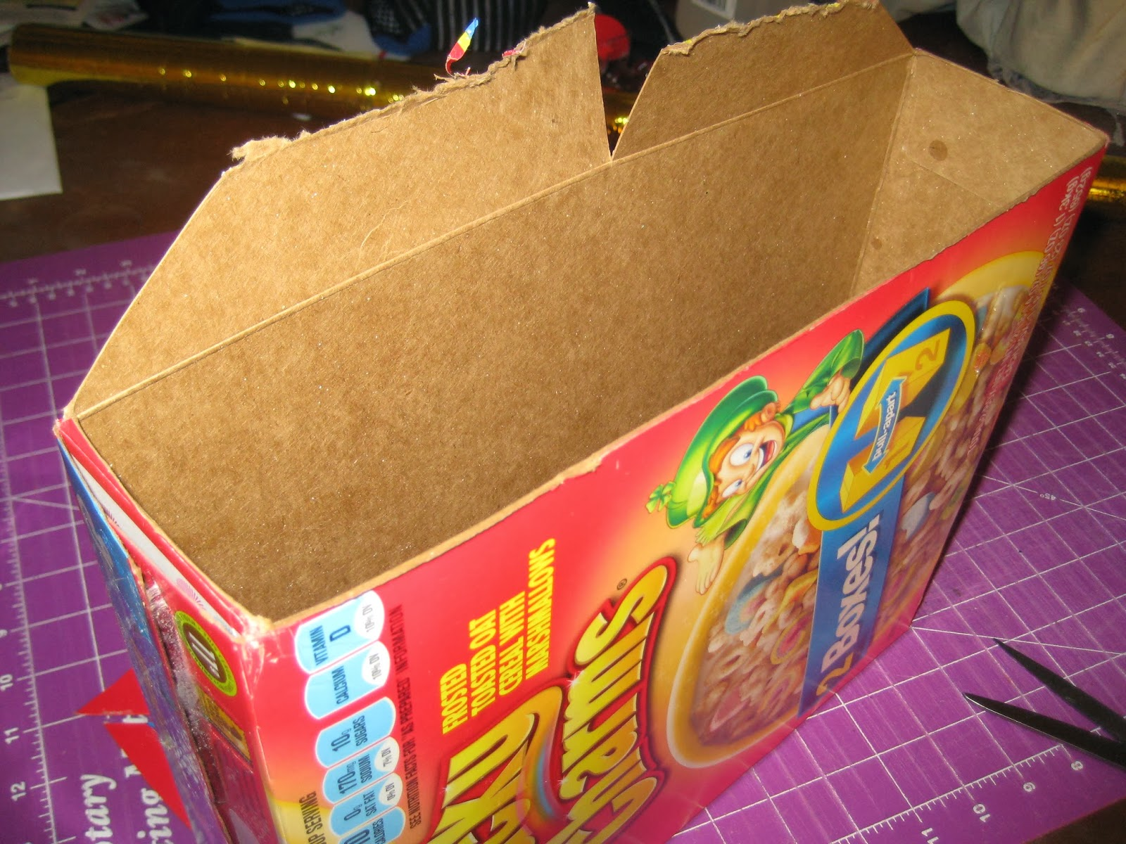 Pondering Cat: Gift bag made from a cereal box.