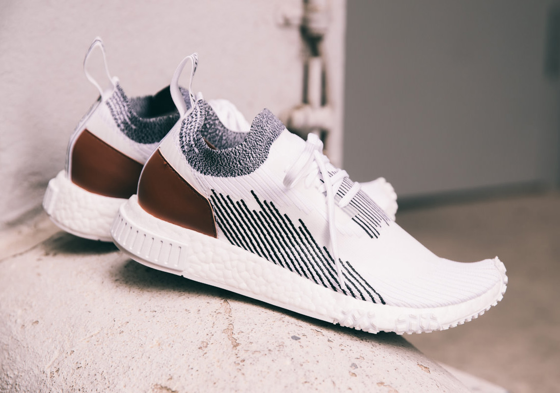 3b07b105eb257 The Whitaker Group is ready to announce the arrival of the Whitaker Car  Club with the release a collaboration with adidas Originals and the NMD  Racer.