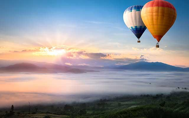 Take a hot air balloon ride at sunrise over the plains of the Serengeti