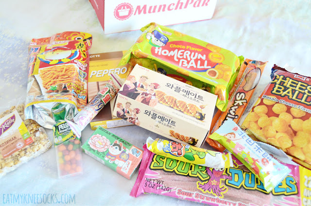 Review of the MunchPak Original subscription snack box, containing sour candy, rice candy, Pepero, waffle cookies, cheese puffs, chocolate treats and more from countries like Japan, Mexico, Korea, Taiwan, and Ukraine.