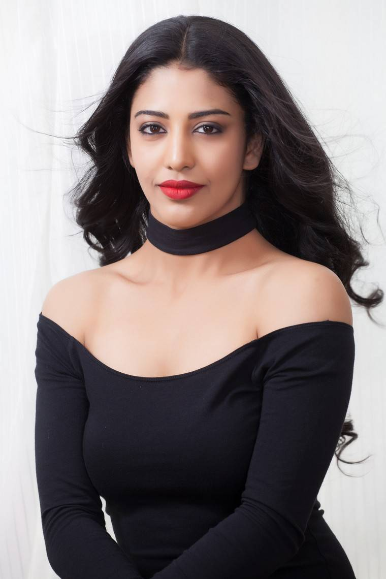 Beautiful Tamil Girl Daksha Nagarkar Long Hair Stills In Mini Black Dress