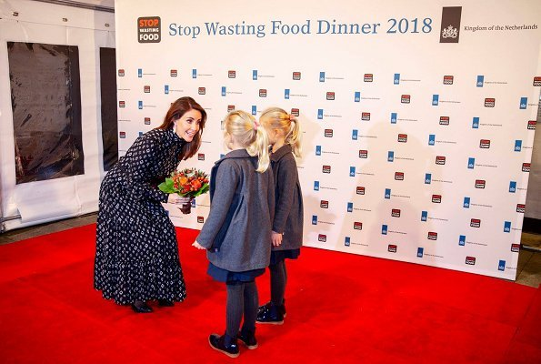 Selina Juul and Ambassador Henk Swarttouw hosted The international Stop Wasting Food Dinner. Princess Marie wore a print maxi dress
