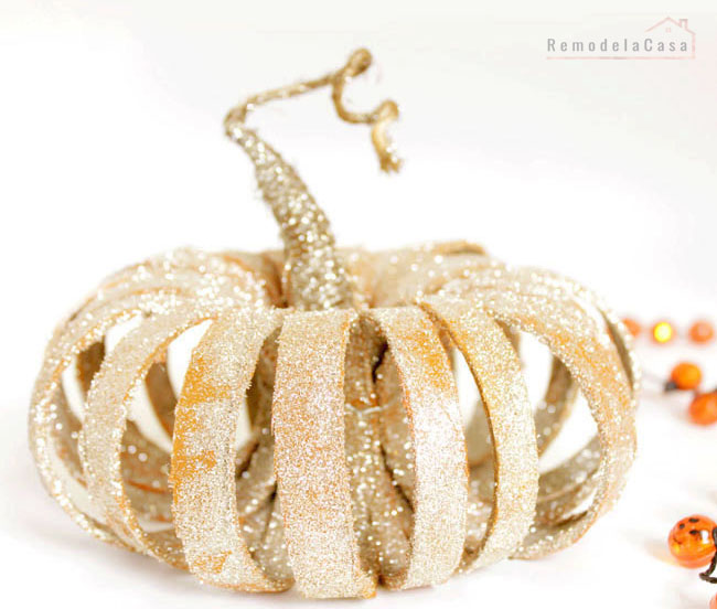 ribbon spools are put together to form a pumpkin.