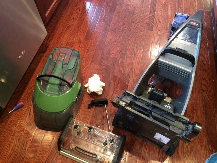 Taking apart your steam cleaner to clean it out.