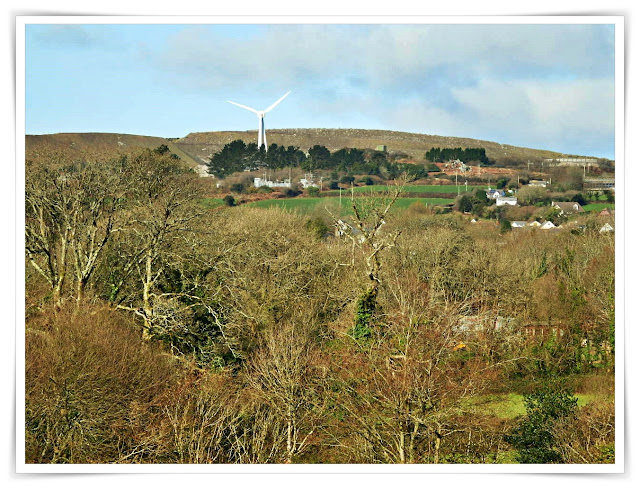 Green fields with a wind turbine on the hill, Cornwall