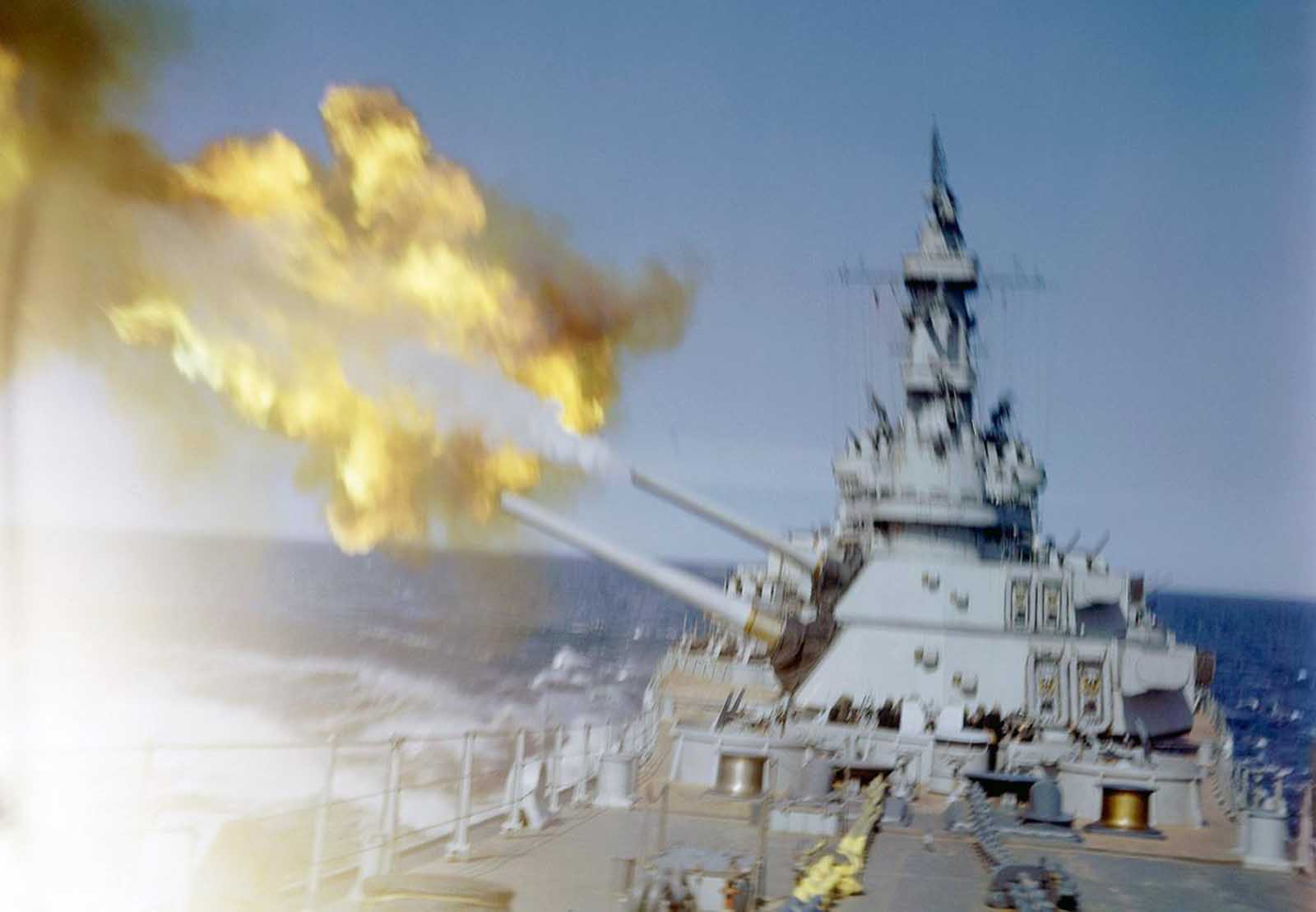 A U.S. cruiser fires her main batteries at Japanese positions on the southern tip of Okinawa, Japan in 1945.