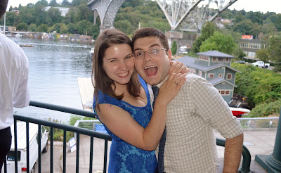couple by the fremont bridge at a wedding