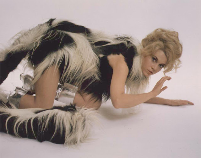 Jane Fonda lying on floor in furs in Barbarella