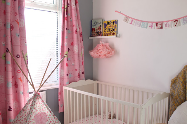 baby girl's bedroom nursery pink and grey theme with tepee, tutu and bunting